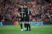 Neymar and Angel Di Maria of Paris Saint-Germain prepare to kick-off after conceding the first goal during the Group C match of the UEFA Champions League between Liverpool and Paris Saint-Germain at Anfield on September 18, 2018 in Liverpool, United Kingdom.