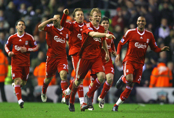 Dirk Kuyt of Liverpool celebrates with his team mates after scoring his team's second goal during the Barclays Premier League match between Liverpool and Tottenham Hotspur at Anfield on January 20, 2010 in Liverpool, England.