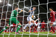 Simon Mignolet of Liverpool and an offside Gareth Barry of West Bromwich Albion watch on as Craig Dawson of West Bromwich Albion scores a goal which is later dissalowed through the VAR system during The Emirates FA Cup Fourth Round match between Liverpool and West Bromwich Albion at Anfield on January 27, 2018 in Liverpool, England.