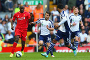 Mario Balotelli of Liverpool is closed down by Sebastian Blanco of West Brom during the Barclays Premier League match between Liverpool and West Bromwich Albion at Anfield on October 4, 2014 in Liverpool, England.