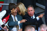 Former Liverpool manager Gerard Houllier looks on during the Barclays Premier League match between Liverpool and West Bromwich Albion at Anfield on October 4, 2014 in Liverpool, England.