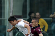 Djamel Mesbah of AS Livorno Calcio fights for the ball with Ryder Matos of ACF Fiorentina during the Serie A match between AS Livorno Calcio and ACF Fiorentina at Stadio Armando Picchi on May 11, 2014 in Livorno, Italy.