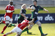 Nick Strachan of Soth Canterbury is tackled by Daniel Harris of Poverty Bay during the Lochore Cup Final match between South Canterbury and Poverty Bay at Alpine Energy Stadium on October 8, 2011 in Timaru, New Zealand.