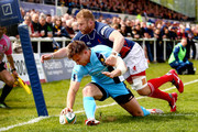 Sam Smith of Worcester touches down a try avoiding a tackle by Mark Bright of London Scottish during the Greene King IPA Championship play-off first leg match between London Scottish and Worcester Warriors at the Richmond Athletic Ground on May 2, 2015 in Richmond, England.