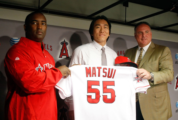 (L-R) General manager Tony Reagins, Hideki Matsui and manager Mike Scioscia of the Los Angeles Angels of Anaheim pose for a portrait during a press conference at Angel Stadium of Anaheim on December 16, 2009 in Anaheim, California.