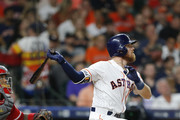 Derek Fisher #21 of the Houston Astros hits a home run in the fifth inning against the Los Angeles Angels of Anaheim at Minute Maid Park on April 24, 2018 in Houston, Texas.