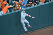 Daniel Nava #25 of the Los Angeles Angels of Anaheim catches a fly ball hit by Manny Machado #13 of the Baltimore Orioles (not pictured) in the first inning during a baseball game at Oriole Park at Camden Yards on July 8, 2016 in Baltimore, Maryland.