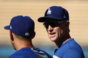 Chase Utley #26 of the Los Angeles Dodgers (R) talks with teammate Austin Barnes #15 during batting practice prior to the MLB game against the Los Angeles Angels of Anaheim at Dodger Stadium on July 13, 2018 in Los Angeles, California.