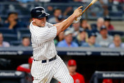 Matt Holliday #17 of the New York Yankees follows through on a fifth inning home run against the Los Angeles Angels of Anaheim at Yankee Stadium on June 21, 2017 in the Bronx borough of New York City.
