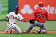 Jimmy Rollins #11 of the Philadelphia Phillies is unable to catch the ball on a successful steal by Raul Ibanez #28 of the Los Angeles Angels in the first inning at Citizens Bank Park on May 14, 2014 in Philadelphia, Pennsylvania.