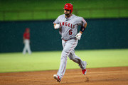Albert Pujols #5 of the Los Angeles Angels of Anaheim runs the bases after hitting a solo home run in the second inning against the Texas Rangers  at Globe Life Park in Arlington on August 18, 2018 in Arlington, Texas.