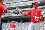 Ian Kinsler #3 of the Los Angeles Angels of Anaheim congratulates teammate Jose Fernandez #20 on scoring a run against the Minnesota Twins during the fourth inning of the game on June 10, 2018 at Target Field in Minneapolis, Minnesota. The Twins defeated the Angels 7-5.