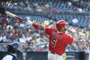 Albert Pujols #5 of the Los Angeles Angels hits a sacrifice fly during the first inning of a baseball game against the San Diego Padres at PETCO Park on August 15, 2018 in San Diego, California.