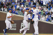 Carlos Gonzalez #2, Kyle Schwarber #12, and Anthony Rizzo #44 of the Chicago Cubs celebrate the 8-1 win against the Los Angeles Angels of the Chicago Cubs at Wrigley Field on June 03, 2019 in Chicago, Illinois.