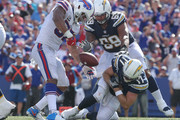 Philip Rivers #17 of the Los Angeles Chargers is sacked by Lorenzo Alexander #57 of the Buffalo Bills during NFL game action at New Era Field on September 16, 2018 in Buffalo, New York.