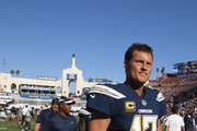 Quarterback Philip Rivers #17 of the Los Angeles Chargers leaves the field after his team was defeated by the Rams 35-23 at Los Angeles Memorial Coliseum on September 23, 2018 in Los Angeles, California.