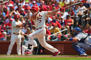 Matt Holliday #7 of the St. Louis Cardinals hits a two-RBI single in the first inning against the Los Angeles Dodgers at Busch Stadium on July 19, 2014 in St. Louis, Missouri.