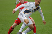 Sebastian Lletget #17 of Los Angeles Galaxy controls the ball in front of Dax McCarty #6 of Chicago Fire at Toyota Park on April 14, 2018 in Bridgeview, Illinois. The Galaxy defeated the Fire 1-0.