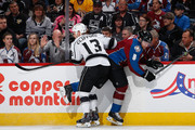 Kyle Clifford #13 of the Los Angeles Kings puts a hit on Jan Hejda #8 of the Colorado Avalanche at Pepsi Center on March 10, 2015 in Denver, Colorado.