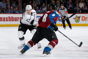 Dustin Brown #23 of the Los Angeles Kings takes a shot against Jan Hejda #8 of the Colorado Avalanche at Pepsi Center on March 10, 2015 in Denver, Colorado.  The Kings defeated the Avalanche 5-2