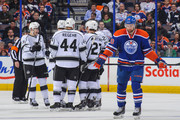 (L to R) Dustin Brown #23, Kyle Clifford #13, Robyn Regehr #44, Alec Martinez #27, and Jarret Stoll #28 celebrate Martinez's goal against the Edmonton Oilers of the Los Angeles Kings during an NHL game at Rexall Place on March 09, 2014 in Edmonton, Alberta, Canada.
