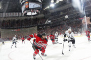Dainius Zubrus #8 of the New Jersey Devils charges the puck as Robyn Regehr #44 of the Los Angeles Kings chasses during the first period at Prudential Center on March 23, 2015 in Newark, New Jersey.