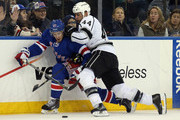 Robyn Regehr #44 of the Los Angeles Kings slows down Ryan McDonagh #27 of the New York Rangers during the second period at Madison Square Garden on November 17, 2013 in New York City.