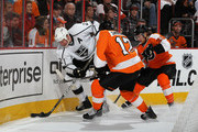 Matt Greene #2 of the Los Angeles Kings tries to clear the puck from Wayne Simmonds #17 and Claude Giroux #28 of the Philadelphia Flyers against on October 15, 2011 at Wells Fargo Center in Philadelphia, Pennsylvania.
