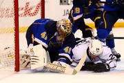 Jaroslav Halak #41 of the St. Louis Blues makes a save against Colin Fraser #24 of the Los Angeles Kings at the Scottrade Center on January 16, 2014 in St. Louis, Missouri.