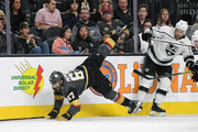 Max Pacioretty #67 of the Vegas Golden Knights gets tripped up as he tries to get by Oscar Fantenberg #7 and Tanner Pearson #70 of the Los Angeles Kings in the second period of their preseason game at T-Mobile Arena on September 28, 2018 in Las Vegas, Nevada. The Golden Knights defeated the Kings 2-0.
