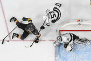 William Carrier #28 of the Vegas Golden Knights tries to take a shot as he falls on the ice against Jonathan Quick #32 of the Los Angeles Kings as Kevin Gravel #53 of the Kings defends in the second overtime of Game Two of the Western Conference First Round at T-Mobile Arena on April 13, 2018 in Las Vegas, Nevada. The Golden Knights won 2-1 in double overtime.