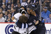 Evander Kane #9 of the Winnipeg Jets fights with Colin Fraser #24 of the Los Angeles Kings in second period action during an NHL home opener game at the MTS Centre on October 4, 2013 in Winnipeg, Manitoba, Canada.