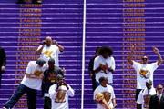 Members of the Los Angeles Lakers walk down the steps during the 2009 NBA Championship Victory Parade at the Los Angeles Memorial Coliseum on June 17, 2009 in Los Angeles, California.
