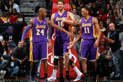 Kobe Bryant #24, Pau Gasol #16 and Wesley Johnson #11 of the Los Angeles Lakers enjoy a laugh at the end of the first half against the Atlanta Hawks at Philips Arena on December 16, 2013 in Atlanta, Georgia.  NOTE TO USER: User expressly acknowledges and agrees that, by downloading and or using this photograph, User is consenting to the terms and conditions of the Getty Images License Agreement.