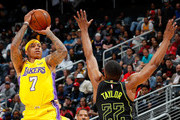 Isaiah Thomas #7 of the Los Angeles Lakers attempts a basket against Isaiah Taylor #22 of the Atlanta Hawks at Philips Arena on February 26, 2018 in Atlanta, Georgia.  NOTE TO USER: User expressly acknowledges and agrees that, by downloading and or using this photograph, User is consenting to the terms and conditions of the Getty Images License Agreement.