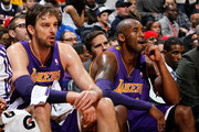 Pau Gasol #16 and Kobe Bryant #24 of the Los Angeles Lakers look on during the game against the Atlanta Hawks at Philips Arena on December 16, 2013 in Atlanta, Georgia.  NOTE TO USER: User expressly acknowledges and agrees that, by downloading and or using this photograph, User is consenting to the terms and conditions of the Getty Images License Agreement.