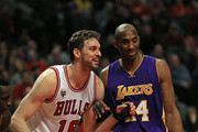 Pau Gasol #16 of the Chicago Bulls and Kobe Bryant #24 of the Los Angeles Lakers smile and chat as they await a free-throw at the United Center on February 21, 2016 in Chicago, Illinois. The Bulls defeated the Lakers 126-115. NOTE TO USER: User expressly acknowledges and agrees that, by downloading and or using the photograph, User is consenting to the terms and conditions of the Getty Images License Agreement.