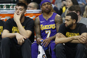 Isaiah Thomas #7 of the Los Angeles Lakers sits on the bench as the Lakers play the Dallas Mavericks in the second half at American Airlines Center on February 10, 2018 in Dallas, Texas. The Mavericks won 130-123.