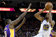 Kevin Durant #35 of the Golden State Warriors shoots over Luol Deng #9 of the Los Angeles Lakers in the second half of their NBA basketball game at ORACLE Arena on November 23, 2016 in Oakland, California. NOTE TO USER: User expressly acknowledges and agrees that, by downloading and or using this photograph, User is consenting to the terms and conditions of the Getty Images License Agreement.