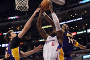 DeAndre Jordan #6 of the Los Angeles Clippers attempts to dunk the ball on Pau Gasol #16 and Kobe Bryant #24 of the Los Angeles Lakers during a 102-94 Clipper win at Staples Center on January 14, 2012 in Los Angeles, California.  NOTE TO USER: User expressly acknowledges and agrees that, by downloading and/or using this Photograph, user is consenting to the terms and conditions of the Getty Images License Agreement.