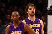 (L-R) Kobe Bryant #24 and Pau Gasol #16 of the Los Angeles Lakers look on against the New York Knicks at Madison Square Garden on February 10, 2012 in New York City.  NOTE TO USER: User expressly acknowledges and agrees that, by downloading and or using this photograph, User is consenting to the terms and conditions of the Getty Images License Agreement.