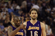 Kobe Bryant #24 and Pau Gasol #16 of the Los Angeles Lakers walk off the court for halftime after the Lakers made a last second shot against the Sacramento Kings at ARCO Arena on November 3, 2010 in Sacramento, California.  NOTE TO USER: User expressly acknowledges and agrees that, by downloading and or using this photograph, User is consenting to the terms and conditions of the Getty Images License Agreement.