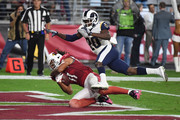 Wide receiver Larry Fitzgerald #11 of the Arizona Cardinals scores a touchdown over free safety Lamarcus Joyner #20 of the Los Angeles Rams during the second quarter of the NFL game at the University of Phoenix Stadium on December 3, 2017 in Glendale, Arizona.