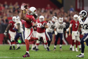 Wide receiver Larry Fitzgerald #11 of the Arizona Cardinals runs with the football after a reception against the Los Angeles Rams during the NFL game at the University of Phoenix Stadium on December 3, 2017 in Glendale, Arizona. The Rams defeated the Cardinals 32-16.