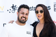 Off the Menu Founder & CEO Lawrence Longo and Actress Shay Mitchell attend the Los Angeles Times Food Bowl - Secret Burger Showdown at Wallis Annenberg Center for the Performing Arts on May 26, 2018 in Beverly Hills, California.