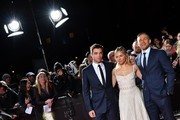 """English actor Charlie Hunnam (R), English actor Robert Pattinson (L) and English actress Sienna Miller pose upon arrival at the UK premiere of the film """"The Lost City Of Z"""" at The British Museum in London on February 16, 2017. / AFP / Ben STANSALL"""