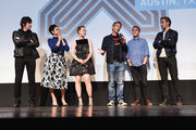 """(L-R) Composer Johnny Jewel, actors Eva Mendes, Saoirse Ronan, Ben Mendelsohn and Iain De Caestecker, and director/writer Ryan Gosling take part in a Q&A following the """"Lost River""""  premiere during the 2015 SXSW Music, Film + Interactive Festival at Topfer Theatre at ZACH on March 14, 2015 in Austin, Texas."""