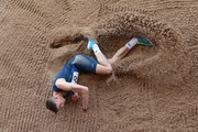 Aidan Quinn of Scotland U20's lands in the sand pit during the Men's Triple Jump event at the Loughborough International Athletics event on May 20, 2018 in Loughborough, England.
