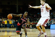 Chris Jones #3 of the Louisville Cardinals drives to the basket past Will Magarity #11 of the Boston College Eagles in the first half during the game at Conte Forum on January 28, 2015 in Chestnut Hill, Massachusetts.