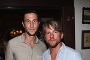 Actors Pablo Schreiber and  Zachary Knighton attend For Love and Lemons annual SKIVVIES party co-hosted by Too Faced and performance by The Shoe at The Carondelet House on July 31, 2014 in Los Angeles, California.